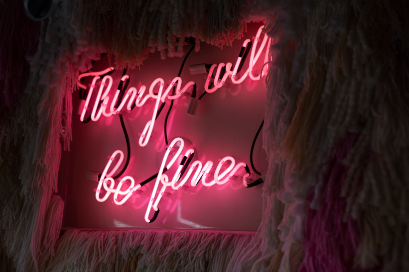 A neon sign showing the encouraging message 'things will be fine'